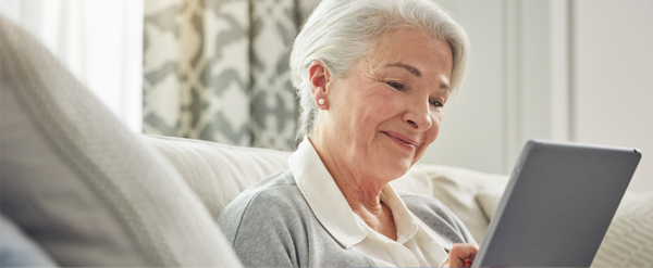 Senior woman reading off a tablet