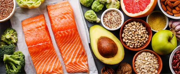 Salmon, fruit and bowls of nuts