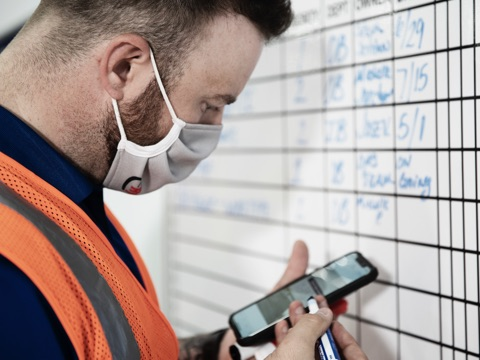 Worker using app