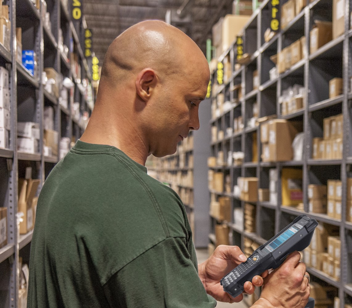 warehouse worker with Zebra mobile computer